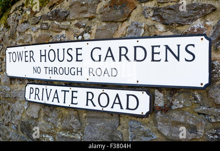 Private road sign on an old stone wall in Southern England, UK. - Stock Photo