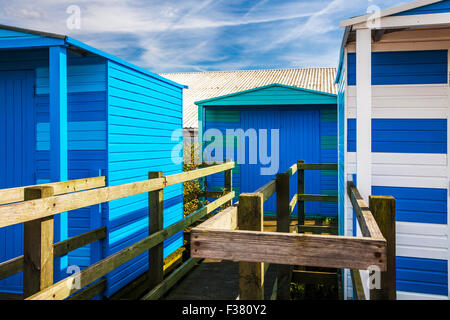 Colourful wooden beach huts in the Kentish coastal resort of Whitstable. - Stock Photo