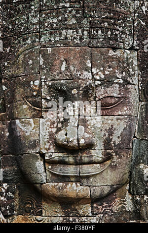 Carved stone giant face at Bayon temple. Angkor Archaeological Park, Siem Reap Province, Cambodia.