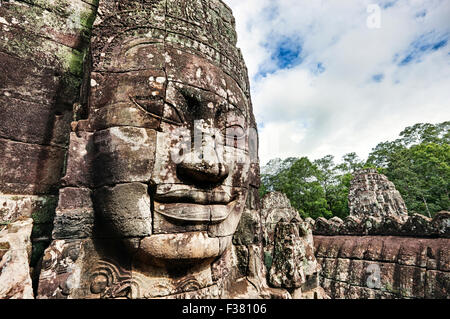 Carved stone giant face at Bayon temple in Angkor Thom. Angkor Archaeological Park, Siem Reap Province, Cambodia.