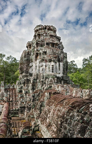 Carved stone giant faces at the Bayon temple. Angkor Thom, Angkor Archaeological Park, Siem Reap Province, Cambodia.