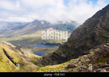 Carrauntoohil mountainside and Hags Glen seen from Beenkeragh ridge in MacGillycuddy Reeks, County Kerry, Eire, - Stock Photo