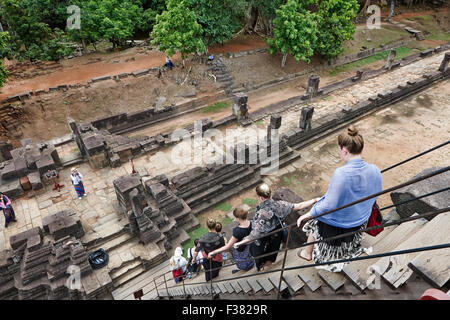 Visitors descending from the top level of Baphuon temple. Angkor Archaeological Park, Siem Reap Province, Cambodia. - Stock Photo