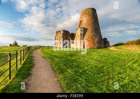 The ruins of St Benet's Abbey and it's ajoining windmill on the Norfolk Broads. - Stock Photo