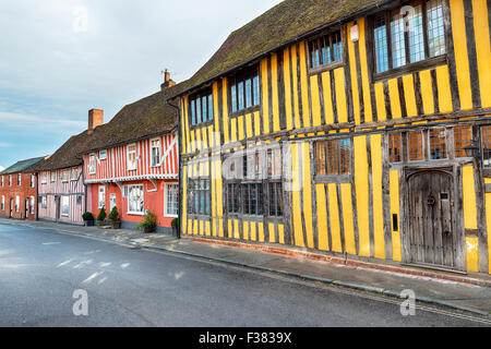 Colourful Tudor half timbered houses at Lavenham in Suffolk - Stock Photo