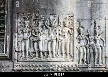 Bas-relief of apsaras (celestial dancers) in Angkor Wat temple. Angkor Archaeological Park, Siem Reap Province, - Stock Photo