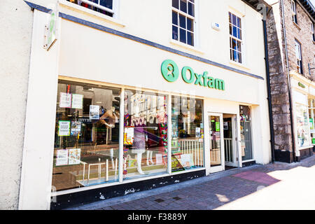 Oxfam Charity shop store sign exterior front facade high street shopping Kendal Cumbria UK England - Stock Photo