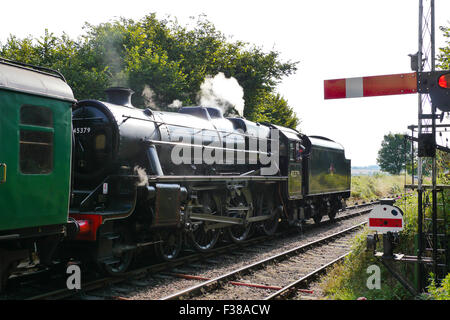 Stanier Black Five 4-6- 0 steam locomotive number 45379 pulls away in reverse with a train from Ropley Station on - Stock Photo