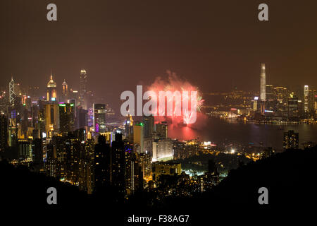 Fireworks celebration for the National Day of China in the Victoria Harbour of Hong Kong. - Stock Photo