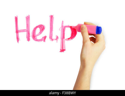 Female hand writing the word 'Help' with pink marker on a white background - Stock Photo