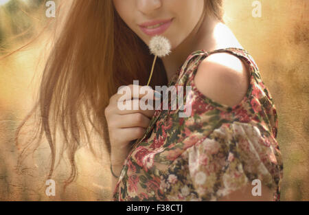 half face of a woman rose lips dandelion blonde hair - Stock Photo