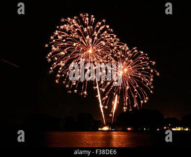 Fourth of July fireworks over Milavek Lake - Stock Photo