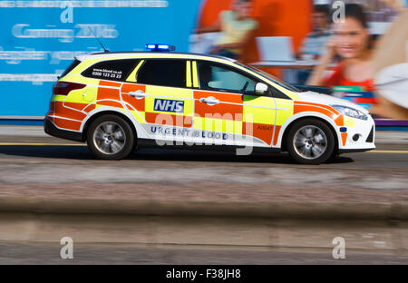 A blurred urgent blood response vehicle with sirens and blue lights speeding through Liverpool City Centre, Merseyside, - Stock Photo