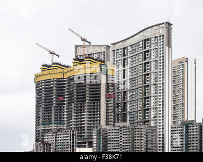 Skyscraper under construction, at Dhobi Ghat, Mumbai, India - Stock Photo