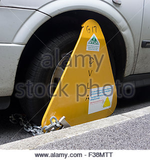 A DVLA wheel clamp on an untaxed vehicle on the streets of Sheffield, England, UK - Stock Photo