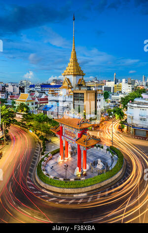 Bangkok, Thailand at Chinatown's traffic circle and Wat Traimit. - Stock Photo