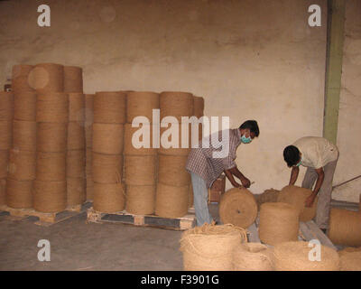 coir yarn - a product of green industry based on coconut fruit from coconut palm. - Stock Photo