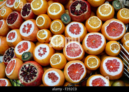 Oranges, grapefruit and pomegranate, cut open, at a market stall, Istanbul, Turkey - Stock Photo