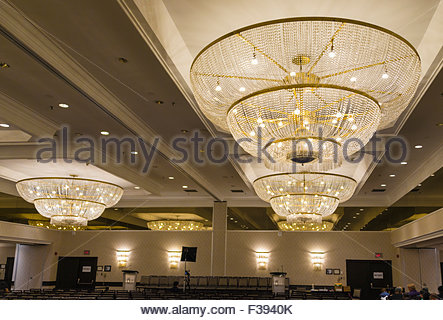 Antique lighting glass chandeliers in shop central athens greece conference hall with big chandeliers and several rows of vacant chairs there is a dais mozeypictures Choice Image