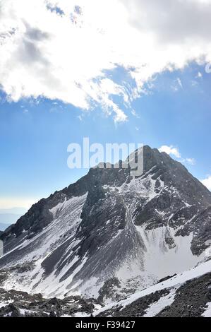 Yulong Snow Mountain in Yunnan, China - Stock Photo