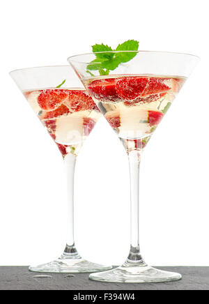 Strawberry cocktail with berries in martini glass isolated on white background. Festive arrangement with sparkling - Stock Photo