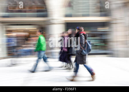 Blurred pedestrian, people walking in city - Stock Photo