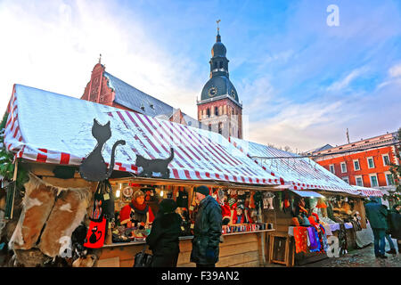 RIGA, LATVIA - DECEMBER 28, 2014: People buying traditional souvenirs at a European Christmas market in Old Riga, - Stock Photo