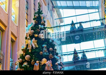 RIGA, LATVIA - DECEMBER 24, 2014: Beautifully decorated Christmas tree in a multilevel shopping mall. Riga, Latvia - Stock Photo