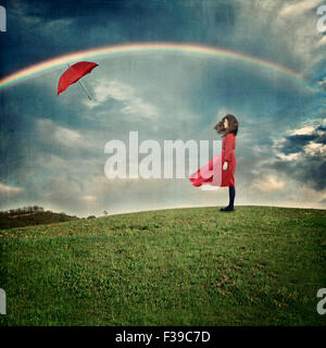 Young woman standing on hill - Stock Photo