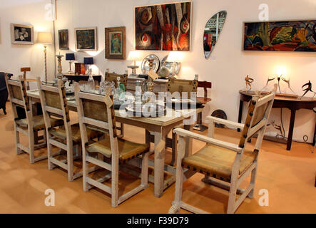 Limed oak dining table and chairs shown by Jonathan Swire at the IADA Fair in Dublin 2015 - Stock Photo