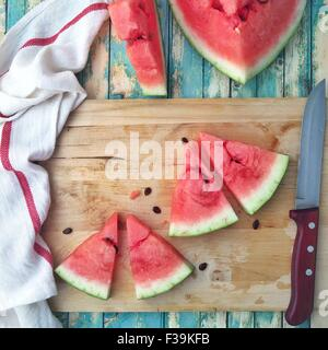 Slices of watermelon on a chopping board - Stock Photo