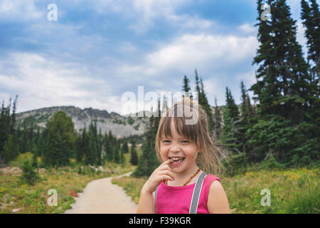 Portrait of a smiling girl in the countryside - Stock Photo