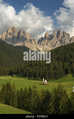 St Johann Church (San Giovanni) in a valley with mountains in background, Dolomites, South Tyrol, Italy