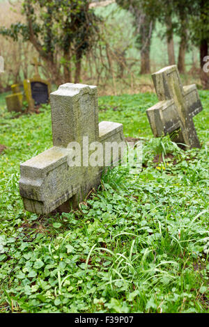 Two old stones cross on an old graveyard - Stock Photo