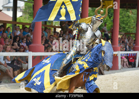 Modern knight on the horse in front of the tribunes. Knights competition, Czech Republic. - Stock Photo