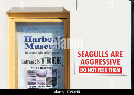 Sign - Seagulls are aggresisve, do not feed them - in Bridlington, East Riding of Yorkshire, England UK - Stock Photo