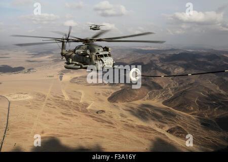November 15, 2013 - A U.S. Marine Corps CH-53E Super Stallion prepares to refuel from a U.S. Air Force HC-130 during in-air refu