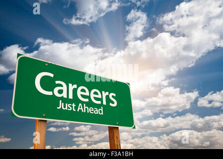 Careers Green Road Sign With Dramatic Clouds and Sky. - Stock Photo