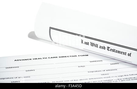 Last Will and Testament rolled up with advance health care directive isolated on white - Stock Photo