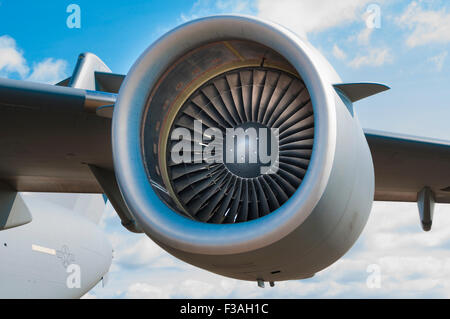 Inlet of the port outer engine on a McDonnell Douglas/Boeing C-17 Globemaster III, showing the fan blades and spinner - Stock Photo