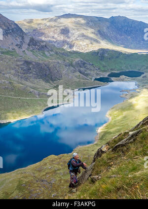 A retired man rock climbing on Lliwedd, part of the Snowdon massif, Wales. route is Avalanche/Red Wall/ Longlands - Stock Photo