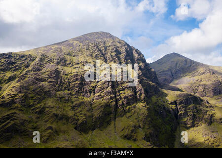View across to Carrauntoohil mountain and Beenkeragh from Cnoc na Toinne in MacGillycuddy Reeks mountains. County - Stock Photo
