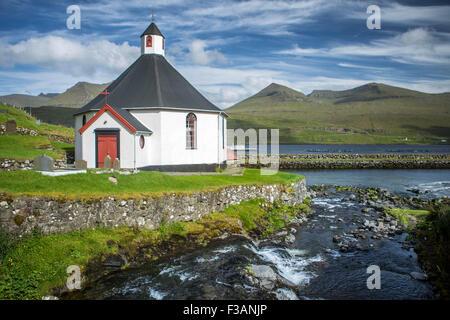 Small village church with cemetery in Faroe Islands, Denmark - Stock Photo