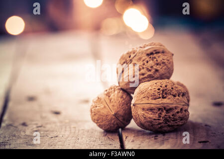 Walnuts on an old wooden table. Christmas background. - Stock Photo