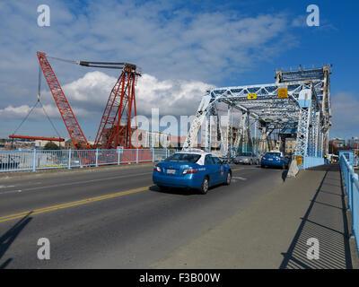 Traffic crossing The Johnson Street Bridge in Victoria, British Columbia. Known locally as the 'Blue Bridge' Showing - Stock Photo