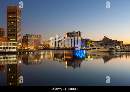 Baltimore skyline at dawn, including the World Trade Center and National Aquarium, reflected in the waters of the - Stock Photo