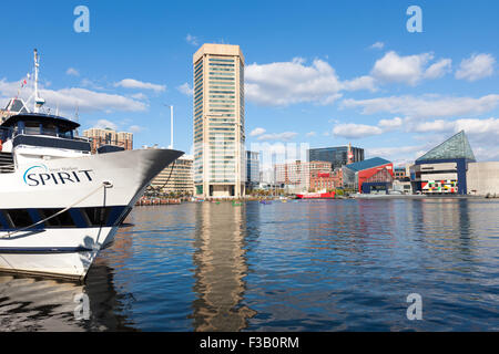 A view of a Spirit Cruises boat and the Inner Harbor in Baltimore, Maryland. - Stock Photo