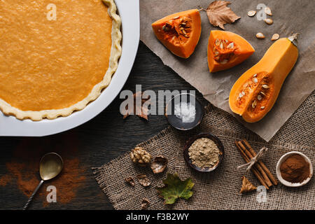 Traditional pumpkin pie cooking process - Stock Photo
