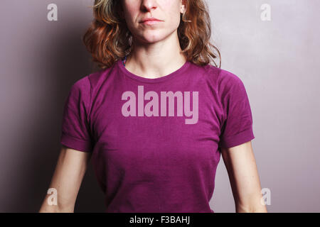 A young woman is wearing a purple top - Stock Photo