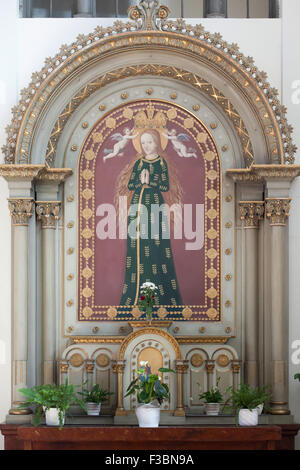 Virgin Mary of Budejovice also known as the Virgin Mary with the Wheat Ears depicted in the side altar of the Church - Stock Photo